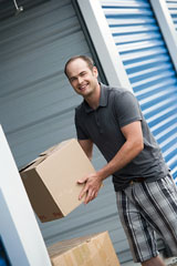 moving boxes into a self-storage garage unit